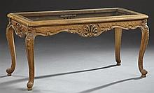 Louis XV Style Carved Walnut Coffee Table, 20th c., the glass top within a rounded edge over a pierced serpentine foliate skirt, on...