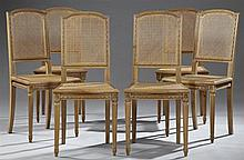 Set of Six Louis XVI Style Carved Walnut Dining Chairs, early 20th c., the arched crest rails over caned backs and bowed seats on ri...