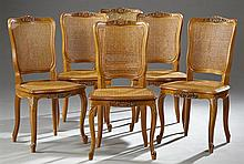 Set of Six Louis XV Style Carved Cherry Dining Chairs, 20th c., with arched backs with central shell carving over caned backs and se...