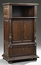 Louis XVI Style Carved Oak Cupboard, 19th c., the rounded edge cornice above open storage supported on full turned and reeded column...