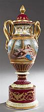 Royal Vienna Polychromed Covered Urn, late 19th c., with snake handles, with reserves of cupid and a maiden and lovers in a garden,...