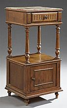Henri II Style Carved Oak Marble Top Nightstand, 19th c., the inset highly figured tan and rouge marble over a frieze drawer, on tur...