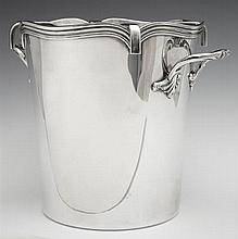 Silverplated Champagne Bucket, 20th c., with a reeded scalloped rim and an interior bottle rack, H.- 7 1/2 in., W.- 10 in., D.- 8 in.