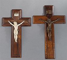 Two Carved Rosewood Crucifixes, early 20th c., one with a patinated bronze Christ figure, the other with a carved ivory figure of Ch...