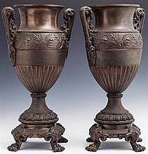 Pair of Patinated Spelter Baluster Garniture Handled Urns, 19th c., the shoulders with relief bands of mythical lion figures and flo...