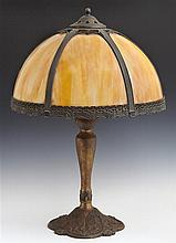 American Art Nouveau Slag Glass Lamp, c. 1910, the domed six panel caramel glass shade on a tapered