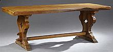 French Provincial Carved Oak Farmhouse Table, 19th c., the thick two board top on a pierced trestle base, on stepped feet, H.- 29 in...