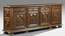 French Louis XIII Style Carved Oak Sideboard, 20th c., the rectangular top over four frieze drawers over four cupboard doors with ap...