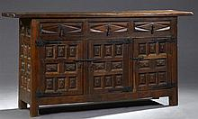 Spanish Carved Oak Sideboard, late 19th c., the thick two board top over three frieze drawers with relief