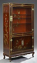 Chinoisserie Red Lacquered Curio Cabinet, 20th c., with an upper glazed door over double lower cupboard doors, with floral and bird...