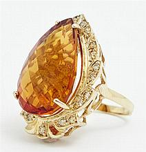 Lady's 14K Yellow Gold Dinner Ring, with a 23.76 carat pear shaped citrine atop a scalloped border of round diamonds, total diamond...