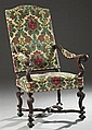 Louis XIV Style Carved Walnut Fauteuil, 19th c., with an arched upholstered high back over floral carved arms to leaf carved cabriol...