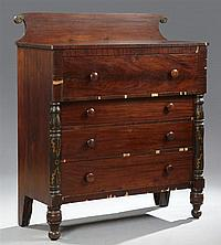 American Carved Mahogany Chest, 19th c., with a scrolled back with brass mounts, with a deep upper drawer over three setback graduat...