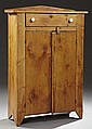American Carved Pine Jelly Cupboard, 19th c., with a peaked backsplash over a frieze drawer and double cupboard doors, H.- 51 3/4 in...