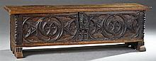 French Gothic Style Carved Oak Coffer, 19th c., the rectangular top lifting to interior storage, with a wrought iron escutcheon over...