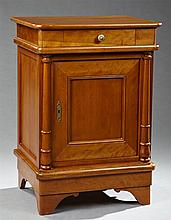 French Louis Philippe Style Carved Cherry Nightstand, 20th c., the curved corner rectangular top over a frieze drawer above a cupboa...
