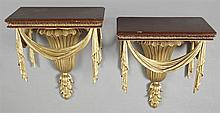 Pair of Neo-Classical Gilt Composition and Wood Wall Brackets, 20th c., the mahogany shelves with pendant drapery garland, on a reed...