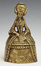 Figural Bronze Table Bell, 19th c., in the form of a woman in 18th c. costume, H.- 6 in., W.- 3 1/2 in., D.- 3 1/4 in.