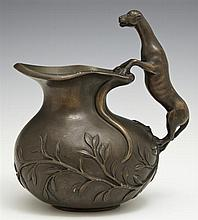 Figural Bronze Baluster Form Pitcher, 19th c., with relief leaf and branch decoration, the handle in the form of a leopard, H.- 6 3/...