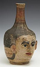 Unusual South American Face Jug, late 19th c., with original paint decoration, H.- 10 1/2 in., W.- 6 in., D.- 7 in.