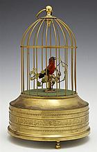 German Singing Bird Automaton, c. 1900, in a brass cage, the feathered bird moving and chirping, working, H.- 10 in., Dia.- 5 3/4 in.