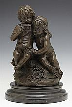 Patinated Bronze Figural Group, 20th c., of musical cherubs on a stepped circular black marble base, H.- 12 1/2 in., Dia.- 8 1/4 in.
