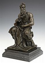 Patinated Bronze Moses Figure, 20th c., after Michaelangelo's original, on a stepped black marble base, H.- 12 in., W.- 6 1/2 in., D..