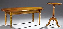 Two French Carved Cherry Tables, 20th c., one an oval coffee table on turned legs, the second a tripodal lamp table with a dished to...