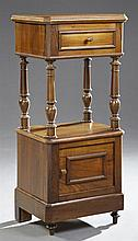 Henri II Style Carved Walnut Nightstand, c. 1880, the canted corner top over a frieze drawer, on turned tapered supports above a low...
