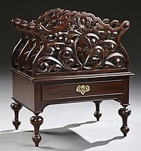 English Regency Style Pierced Mahogany Canterbury, 20th c., the scalloped divided top over a frieze drawer, on turned legs to French...