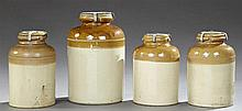 Group of Four Glazed Stoneware Storage Jars, late 19th c., in creme and brown, with sealable lids, Largest- H.- 14 1/2 in ., Dia.- 8...