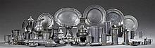 Large Group of French Pewter Objects, 19th and 20th c., including tankards, measures, windup irrigators, chargers, platters, spoons,...