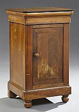 Louis Philippe Carved Walnut Nightstand, 19th c., the rounded corner top over a cavetto frieze drawer above a long cupboard door, on...