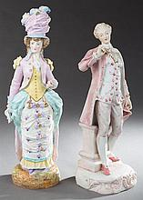 Pair of Continental Style Polychromed Porcelain Figures, 20th c., of a man and woman in 19th c. dress, on relief bases, H.- 16 in.,...