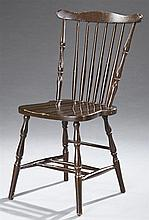 American Comb Back Windsor Side Chair, early 20th c., with turned spindles, now in brown paint, H.- 36 1/2 in., W.- 20 in., D.- 15 1...