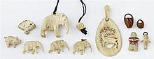 Group of Eleven Carved Items, 19th c., consisting of four bone elephants; a bone pig; a bone Chinese figure; a bone Kewpie pendant;...