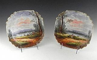 Pair of Limoges Shaped Square Cabinet Plates, 19th c., with landscape scenes of a man and a woman, each with a goat, H.- 1 1/8 in., ...