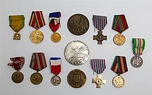 Group of Fourteen Medals and Medallions, 20th c., consisting of a Russian Soviet 70 year armed forces medal, 1918-1988; a Russian So...