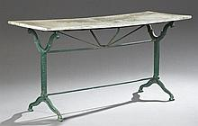 French Industrial Cast Iron Marble Top Bistro Table, late 19th c., the rectangular figured white marble on a trestle base on splayed...