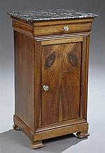 French Louis Philippe Carved Walnut Marble Top Nightstand, 19th c., the curved corner highly figured black marble over a cavetto car...