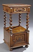 French Henri II Style Carved Walnut Marble Top Nightstand, 19th c., the inset highly figured rouge marble over a frieze drawer, on t...