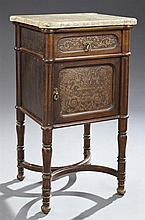 French Louis XVI Style Carved Mahogany Marble Top Nightstand, the highly figured ochre cookie corner marble over a pressed foliate f...