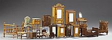 Large Group of Seventeen Pieces of French Doll Furniture, 19th and 20th c., consisting of 6 armoires, a vitrine, 4 beds, a nightstan...