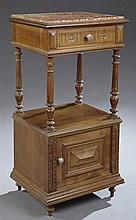 French Henri II Style Carved Mahogany Marble Top Nightstand, 19th c., the highly figured inset rouge marble over a frieze drawer, o...