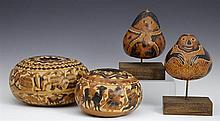Group of Four South American Carved Gourds, 20th c., with figural decoration, two on wooden stands, Largest- H.- 4 1/8 in., Dia.- 7...