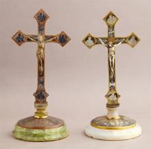 Two Unusual Gilt and Patinated Bronze Table Crucifixes, early 20th c., one on a stepped alabaster base; the second on a stepped gree...