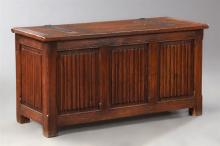 English Style Carved Oak Coffer, 20th c., the rectangular top with decorative iron strap hinges over a linen fold carved paneled cas...