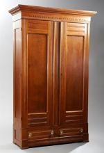 Two Piece American Eastlake Carved Oak Bedroom Suite, c. 1900, consisting of a two door armoire and a Tennessee brown marble top mir...