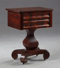 American Classical Revival Carved Mahogany Work Table, late 19th c., the rectangular top over two cavetto carved drawers on a square...