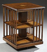 Diminutive Parquetry Inlaid Walnut Revolving Bookmill, 20th c., the burl walnut top centered by an inlaid nautical star, over two sh...